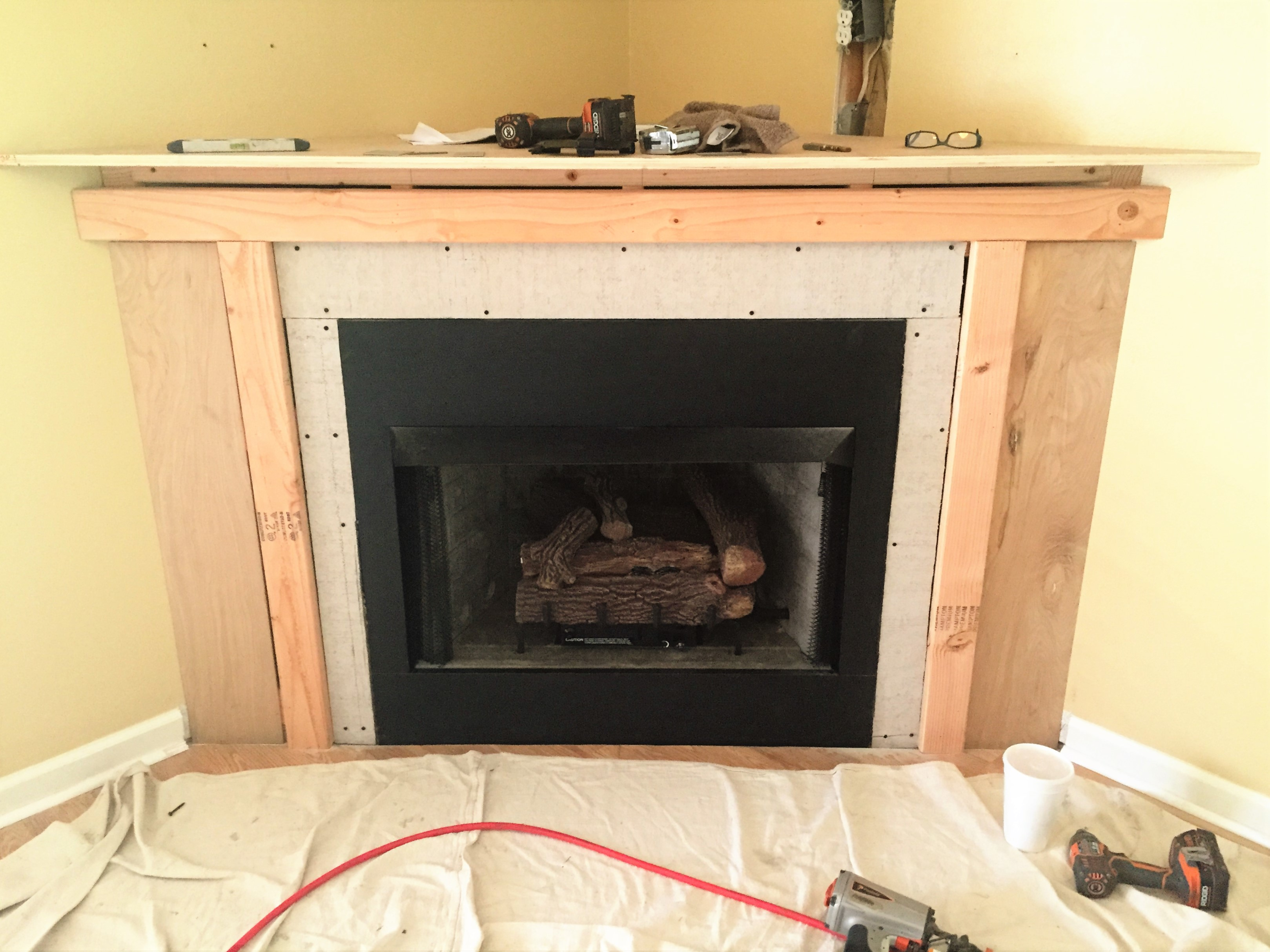 ventless to wooden black fireplace install glass mantle mantel installation amazing installing around ah in contemporary fabulous w construction also gas a